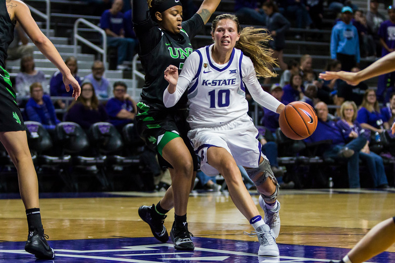 Senior guard Kayla Goth drives the basket during K-State's women's basketball game against North Texas in Bramlage Coliseum on Nov. 16, 2018. At halftime, the Wildcats are in the lead over the Mean Green 35-21. (Logan Wassall | Collegian Media Group)