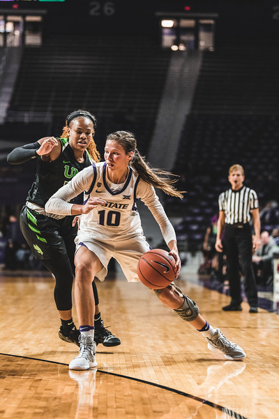 Running right past the North Texas defense, K-State senior Kayla Goth goes in to successfully score. K-State beat the Mean Green 60-42 in Bramlage Coliseum on November 16, 2018. (Alex Todd | Collegian Media Group)