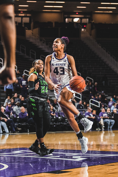 Whizzing past the North Texas defense, Christianna Carr scores two points for K-State. The Wildcats defeated the Mean Green 60-42 in Bramlage Coliseum on November 16, 2018. (Alex Todd | Collegian Media Group)