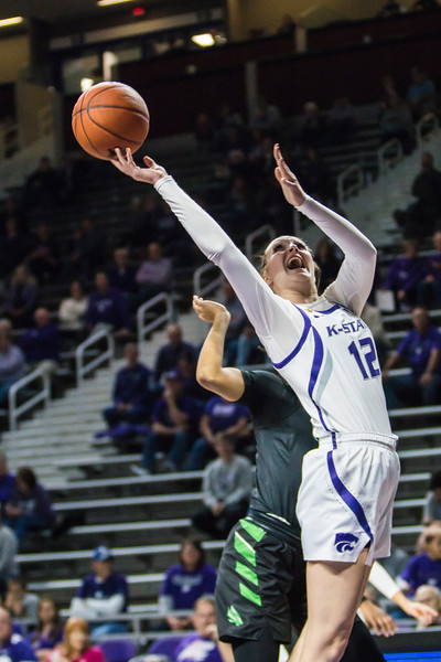 Sophomore guard Rachel Ranke is fouled as she goes up for a shot during K-State's women's basketball game against North Texas in Bramlage Coliseum on Nov. 16, 2018. The Wildcats defeated the Mean Green 60-42. (Logan Wassall | Collegian Media Group)
