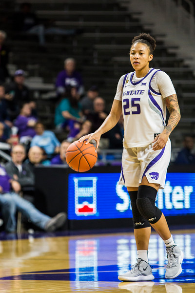 Junior forward Jasauen Beard scans the court for an open teammate during K-State's women's basketball game against North Texas in Bramlage Coliseum on Nov. 16, 2018. The Wildcats defeated the Mean Green 60-42. (Logan Wassall | Collegian Media Group)