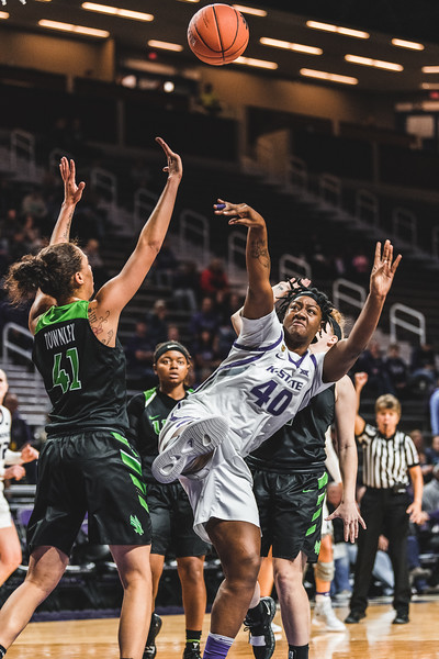 Attempting to score, K-State center Maary Lakes gets fouled by the North Texas defense. K-State won 60-42 in Bramlage Coliseum on November 16, 2018. (Alex Todd | Collegian Media Group)