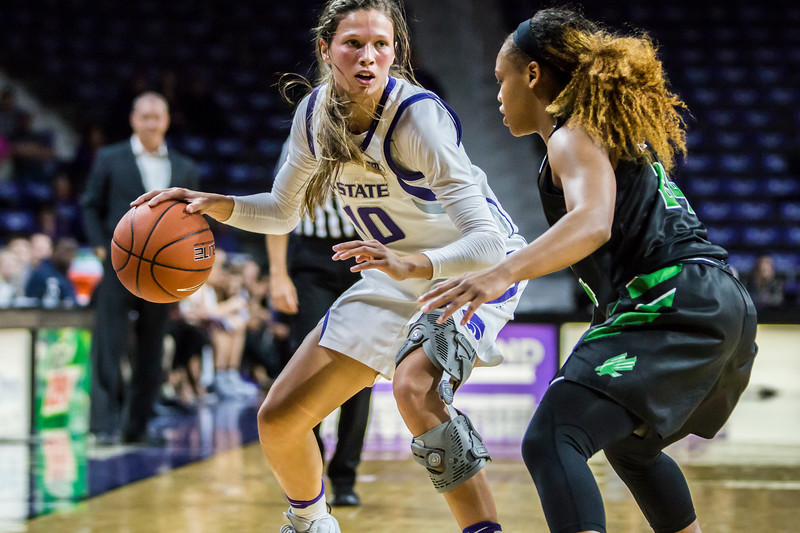 Senior guard Kayla Goth scans the court as she looks for an open teammate during K-State's women's basketball game against North Texas in Bramlage Coliseum on Nov. 16, 2018. The Wildcats defeated the Mean Green 60-42. (Logan Wassall | Collegian Media Group)