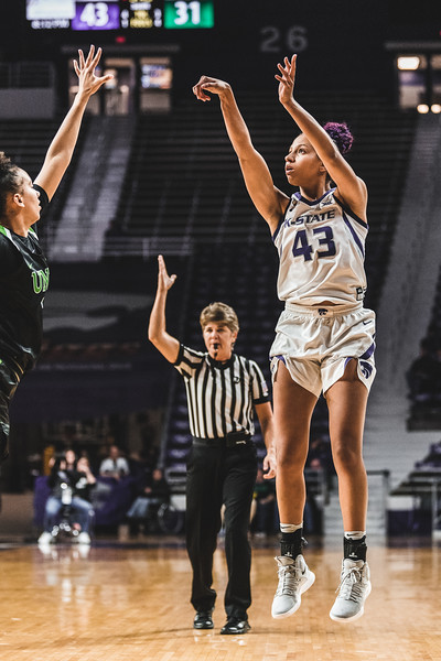 K-State freshman Christianna Carr shoots the ball right over the North Texas defense during Friday's game in Bramlage Coliseum. The Wildcats defeated the Mean Green 60-42. (Alex Todd | Collegian Media Group)