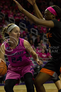 Senior guard, Kindred Wesemann dribbles around the defender during the K-State game against Oklahoma State in Bramlage Coliseum on Jan. 28 2017. (Sabrina Cline | The Collegian)