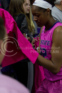 Senior center, Breanna Lewis signs autographs after the K-State game against Oklahoma State in Bramlage Coliseum on Jan. 28 2017. (Sabrina Cline | The Collegian)