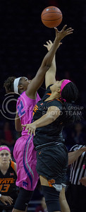 Senior center, Breanna Lewis tips the ball off during the K-State game against Oklahoma State in Bramlage Coliseum on Jan. 28 2017. (Sabrina Cline | The Collegian)