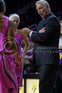 Head coach, Jeff Mittie, talks with his players during a timeout during the K-State game against Oklahoma State in Bramlage Coliseum on Jan. 28 2017. (Sabrina Cline | The Collegian)