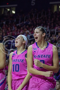 Senior forward Jessica Sheble and sophomore guard Kayla Goth cheer during the K-State game against Oklahoma State in Bramlage Coliseum on Jan. 28, 2017. (Maddie Domnick | The Collegian)