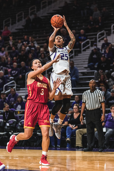 Jumping over the Pittsburg State defense, K-State forward Jasauen Beard shoots to score two points. K-State won 65-50 on November 5, 2018 in Bramlage Coliseum. (Alex Todd | Collegian Media Group)