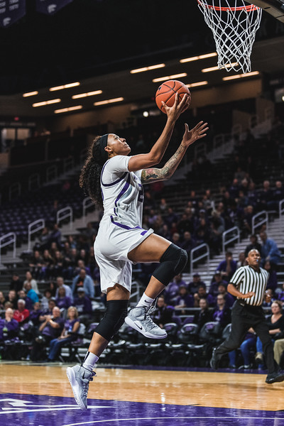 K-State guard Cymone Goodrich leaps up for a layup during Monday nights game against Pittsburg State. K-State beat the Gorillas 65-50. (Alex Todd | Collegian Media Group)