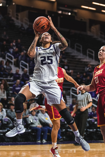 Leaping up to score, K-State junior Jasauen Beard had a total of 11 points during Monday nights game against Pittsburg State. K-State ultimately won 65-50. (Alex Todd | Collegian Media Group)