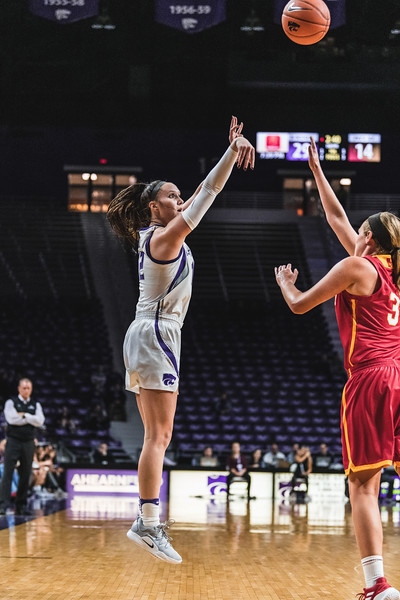 Leaping straight into the air, K-State's Rachel Ranke scores three points during the game on November 5, 2018. K-State beat Pittsburg State 65-50 in Bramlage Coliseum. (Alex Todd | Collegian Media Group)