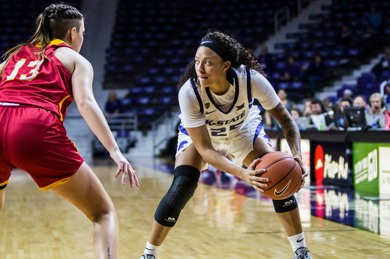 Junior forward Jasauen Beard scans the court for a play in K-State's women's basketball game against Pittsburg State in Bramlage Coliseum on Nov. 5, 2018. The Wildcats took the Gorillas 65-50. (Logan Wassall | Collegian Media Group)