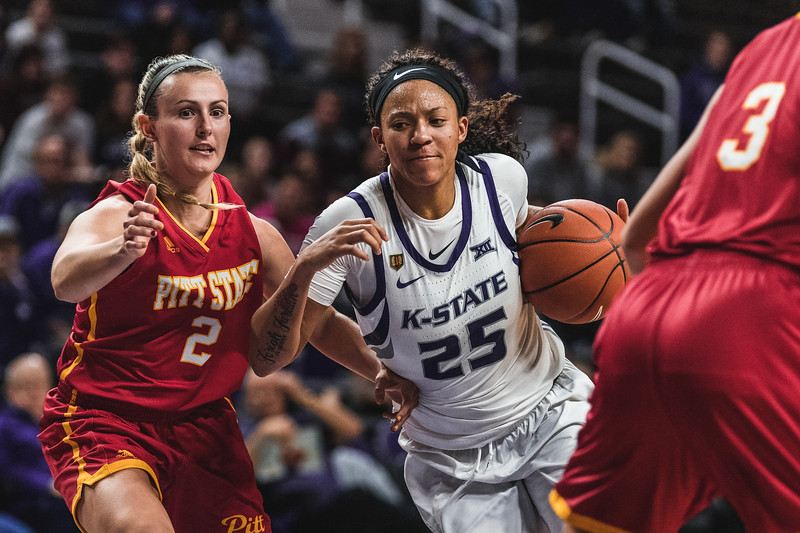 Running towards the goal, K-State forward Jasauen Beard goes right around Pittsburg State's Kaylee DaMitz. Beard contributed to K-State's win on November 5, 2018 with 11 of the 65 total points. (Alex Todd | Collegian Media Group)
