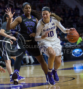 Sophomore guard Kayla Goth runs the ball down the court during the K-State game against TCU in Bramlage Coliseum on Jan. 18, 2017. (Nathan Jones | The Collegian)