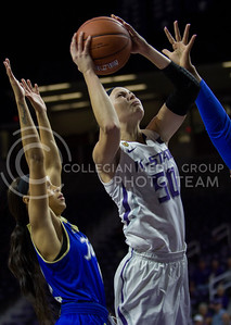 Shaelyn Martin, junior guard, drives the ball and goes up to score during the K-State game against Tulsa in Bramlage Coliseum on Nov. 11, 2016. (Sabrina Cline | The Collegian)