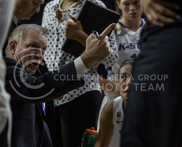 Head coach, Jeff Mittie, discusses his game plan during a timeout in the game against Tulsa in Bramladge on Nov. 11, 2016. (Sabrina Cline | The Collegian)