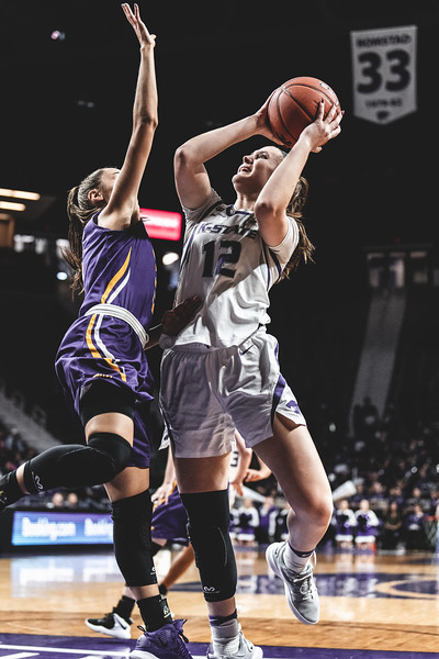 Covered by the UNI defense, Rachel Ranke shoots and scores two points for the cats on December 29, 2018. K-State beat the University of Northern Iowa 72-62 in Bramlage Coliseum. (Alex Todd | Collegian Media Group)