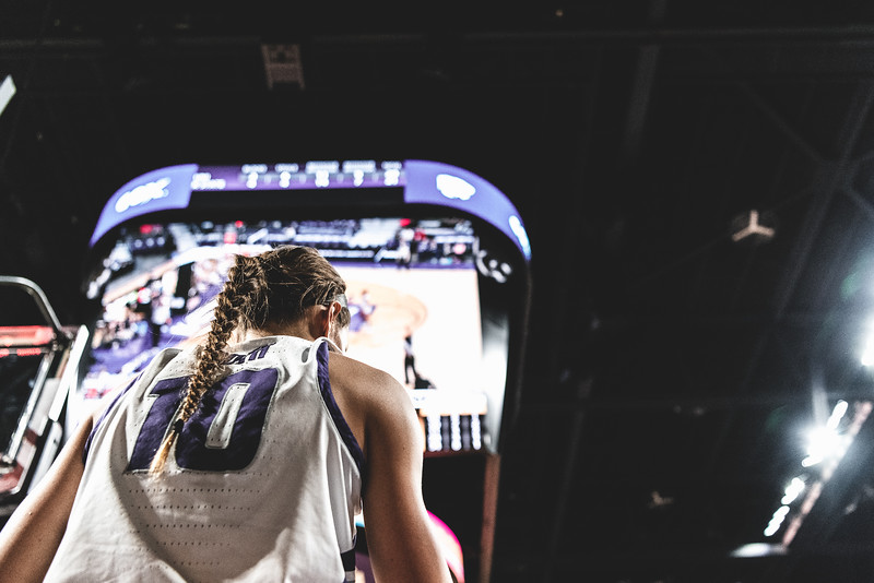 K-State guard Kayla Goth scans the court for an open teammate to pass to during the game against the University of Northern Iowa on December 29, 2018. The Wildcats defeated the Panthers 72-62. (Alex Todd | Collegian Media Group)