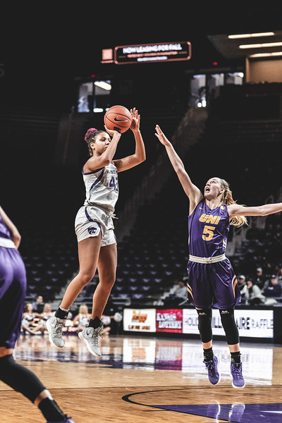 Meeting the University of Northern Iowa defense in the air, K-State guard Christianna Carr shoots and scores 3 points for the Wildcats. K-State beat the Panthers 72-62 on December 29, 2018. (Alex Todd | Collegian Media Group)