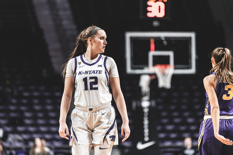 After finishing a play, K-State guard Rachel Ranke keeps an eye on the University of Northern Iowa's offense. K-State defeated the UNI Panthers 72-62 in Bramlage Coliseum on December 29, 2018. (Alex Todd | Collegian Media Group)
