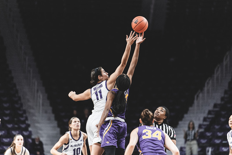 K-State's Peyton Williams reaches out for the ball during the tipoff of the game against the University of Northern Iowa on December 29, 2018. The Wildcats defeated the Panthers 72-62 in Bramlage Coliseum. (Alex Todd | Collegian Media Group)