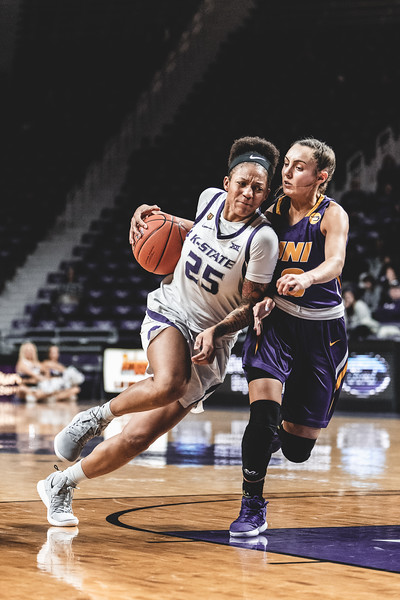 Flying around UNI guard Karli Rucker, K-State forward Jasauen Beard swiftly moves toward the goal to score two points. The Wildcats defeated the Panthers 72-62 on December 29, 2018 in Bramlage Coliseum. (Alex Todd | Collegian Media Group)