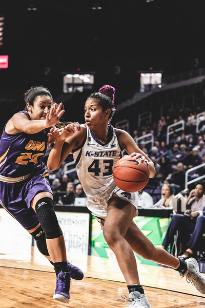 Pushing past the University of Northern Iowa guard Mikaela Morgan, K-State's Christianna Carr makes her way to the goal to score. The Wildcats defeated the Panthers 72-62 on December 29, 2018 in Bramlage Coliseum. (Alex Todd | Collegian Media Group)