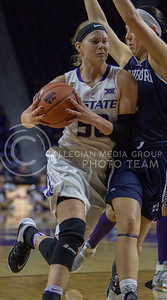 Shaelyn Martin, junior guard, drives the ball and goes up to score during the K-State game against Washburn in Bramlage Coliseum on Nov. 4, 2016. (Sabrina Cline | The Collegian)
