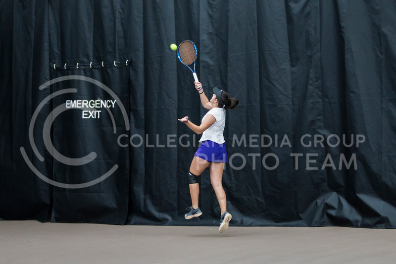 Freshman, Anna Turco, returns the ball against North Texas on Feb. 9, 2018 at Body First Indoor Tennis Center. The Wildcats won 4 matches to 3. (Logan Wassall | Collegian Media Group)