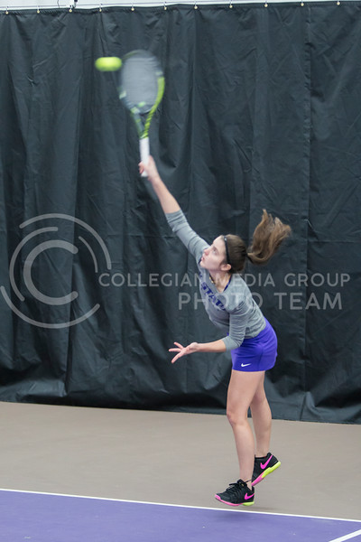Senior, Carolina Costamagna, returns the ball against North Texas on Feb. 9, 2018 at Body First Indoor Tennis Center. The Wildcats won 4 matches to 3. (Logan Wassall | Collegian Media Group)