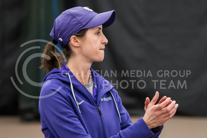 Head tennis coach, Danielle Steinberg, coaches K-State against North Texas on Feb. 9, 2018 at Body First Indoor Tennis Center. The Wildcats won 4 matches to 3. (Logan Wassall | Collegian Media Group)