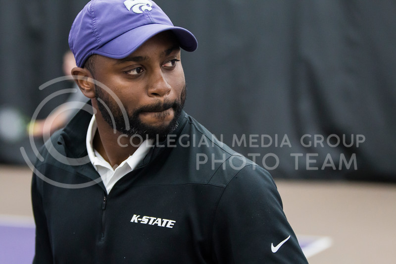 Assistant head tennis coach, Jordan Smith, coaches K-State against North Texas on Feb. 9, 2018 at Body First Indoor Tennis Center. The Wildcats won 4 matches to 3. (Logan Wassall | Collegian Media Group)