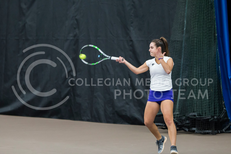 Sophomore, Ines Mesquita, returns the ball against North Texas on Feb. 9, 2018 at Body First Indoor Tennis Center. The Wildcats won 4 matches to 3. (Logan Wassall | Collegian Media Group)