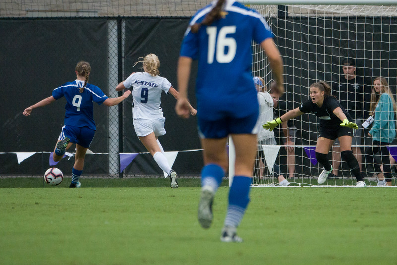 Senior defender Megan Kalkofen redshirt sophomore goalkeeper Emma Malsy attempt to block a goal  during Friday night's game against UMKC. K-State would go on to lose the game 3-2. (Alex Masson | Collegian Media Group)