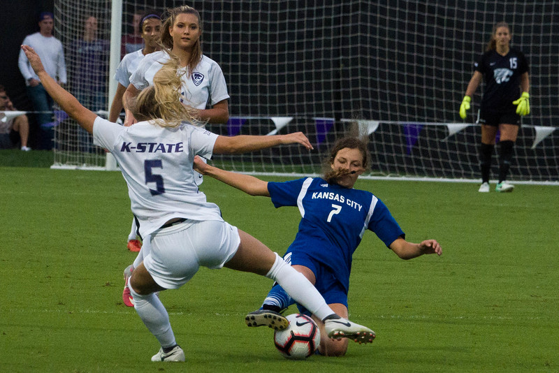 Senior forward Krista Haddock attempts to out-manuever a UMKC defender during Friday night's game against UMKC. K-State would go on to lose the game 3-2. (Alex Masson | Collegian Media Group)