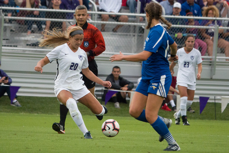 Junior forward Karie Cramer shoots on goal during Friday night's game against UMKC. K-State would go on to lose the game 3-2. (Alex Masson | Collegian Media Group)