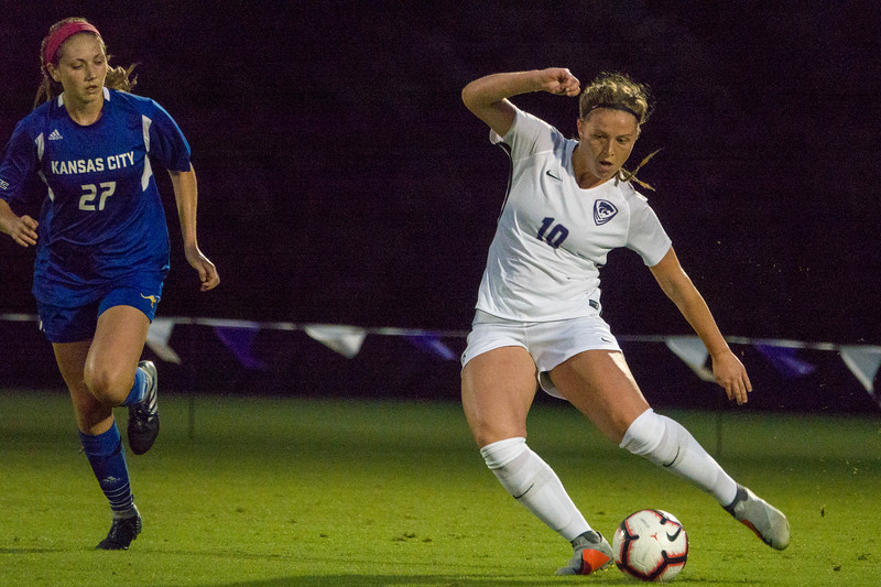 Freshman forward Chloe Fisher attempts to juke a UMKC defender during Friday night's game against UMKC. K-State would go on to lose the game 3-2. (Alex Masson | Collegian Media Group)