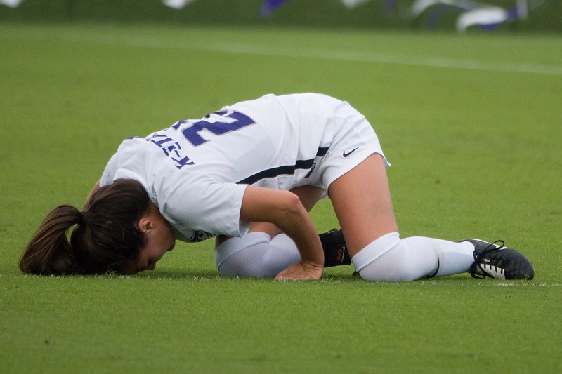 Junior midfielder Laramie Hall crouches over in pain during Friday night's game against UMKC. K-State would go on to lose the game 3-2. (Alex Masson | Collegian Media Group)