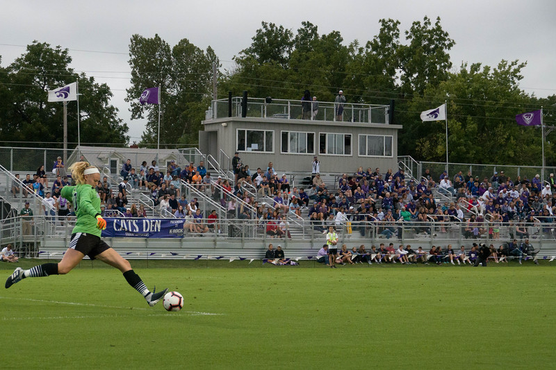 The UMKC goalkeeper kicks the ball back into play infront of the crowd during Friday night's game against UMKC. K-State would go on to lose the game 3-2. (Alex Masson | Collegian Media Group)