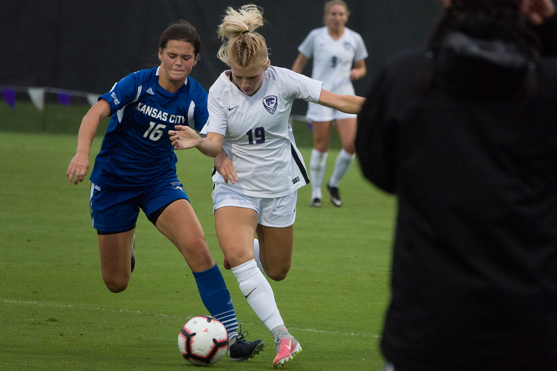 Sophomore midfielder Christina Baxter battles with a UMKC defender during Friday night's game against UMKC. K-State would go on to lose the game 3-2. (Alex Masson | Collegian Media Group)