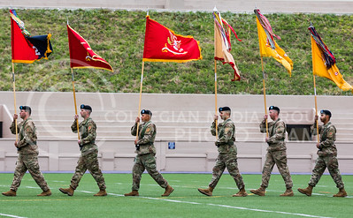 Soldiers carry flags at the World War I Memorial Stadium Dedication Ceremony on April 21, 2017. (John Benfer | The Collegian)