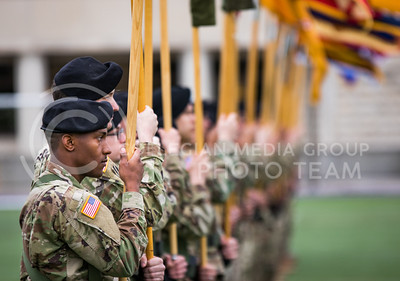 Soldiers hold flags at the World War I Memorial Stadium Dedication Ceremony on April 21, 2017. (John Benfer | The Collegian)