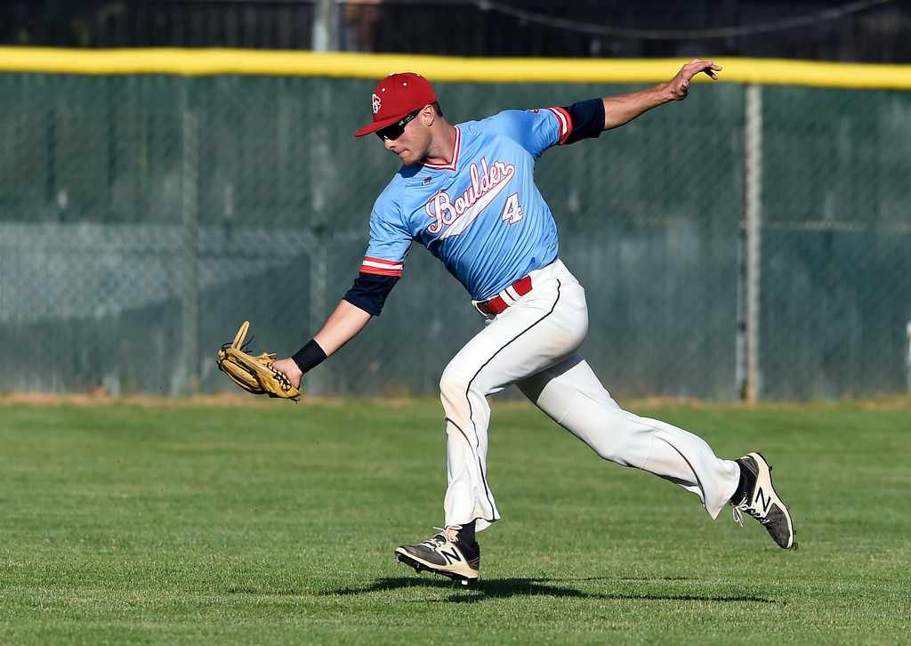 . Boulder Collegians center fielder Brady Michel stretches to make a catch during a game against the Laramie Colts on Friday at Scott Carpenter Park in Boulder. More photos: BoCoPreps.com Jeremy Papasso/ Staff Photographer 06/22/2018
