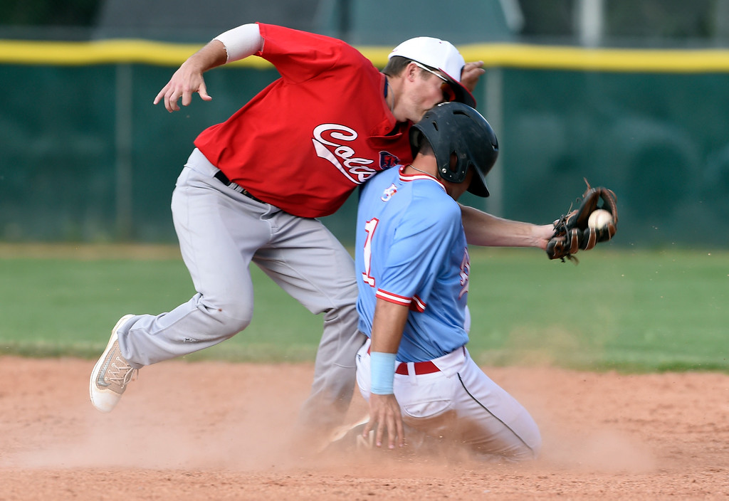 . Boulder Collegians player Mark Goulart collides with Evan Kayser after sliding into second base safely during a game against the Laramie Colts on Friday at Scott Carpenter Park in Boulder. More photos: BoCoPreps.com Jeremy Papasso/ Staff Photographer 06/22/2018