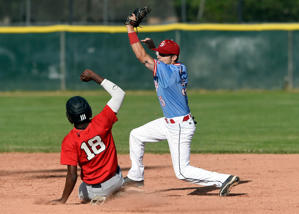 . Boulder Collegians second baseman Brett Erickson misses the tag on Ronald Applewhite at second base during a game against the Laramie Colts on Friday at Scott Carpenter Park in Boulder. More photos: BoCoPreps.com Jeremy Papasso/ Staff Photographer 06/22/2018