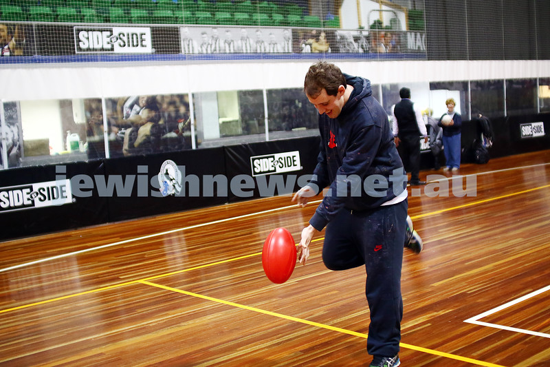 15-6-16. AFL multi cultural round. Members of Maccabi All Abilities working on their football skills at the Collingwood Footbal Club. Photo: Peter Haskin