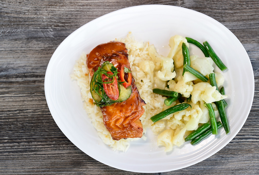 . LONGMONT, CO - JANUARY 30:Miso-Ginger Glazed Salmon features a marinated, pan seared sushi grade Salmon with coconut jasmine rice, seasonal vegetables and a pickled cucumber salad at Collision Brewing Company and restaurant in Longmont on Jan. 30, 2019. (Photo by Matthew Jonas/Staff Photographer)