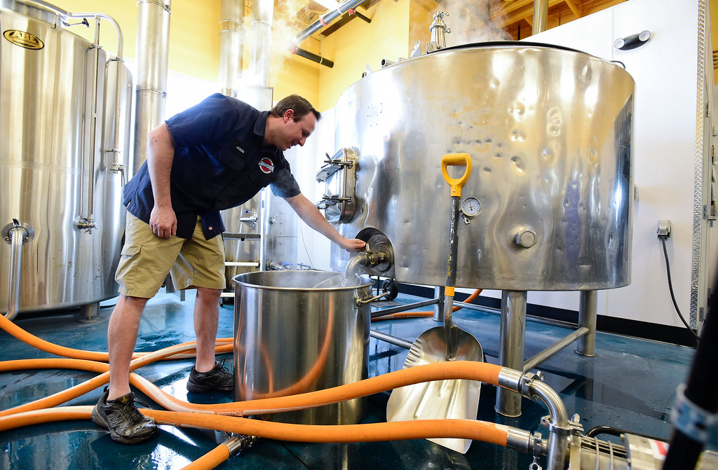 . LONGMONT, CO - JANUARY 30:Head Brewer/Owner Jason Blythe brewing beer at Collision Brewing Company and restaurant in Longmont on Jan. 30, 2019. (Photo by Matthew Jonas/Staff Photographer)